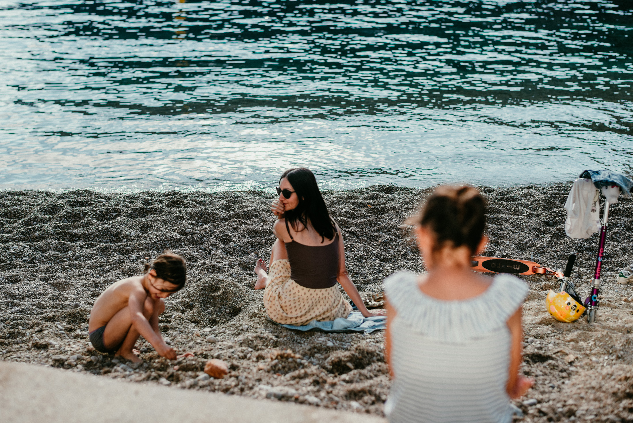 mother and daughters on a beach