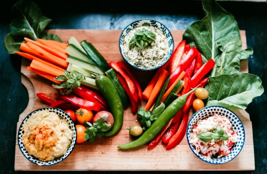a flat lay view of a platter of crudites and dips