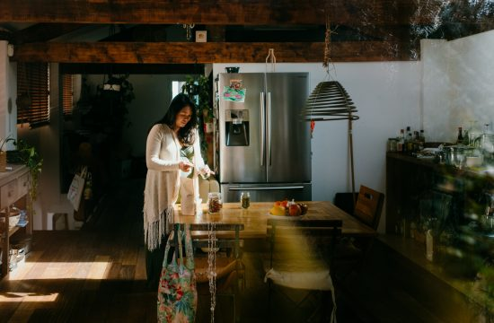 pregnant mum standing in her open plan kitchen dining area