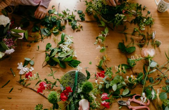 colourful flowers and petals scattered on a table